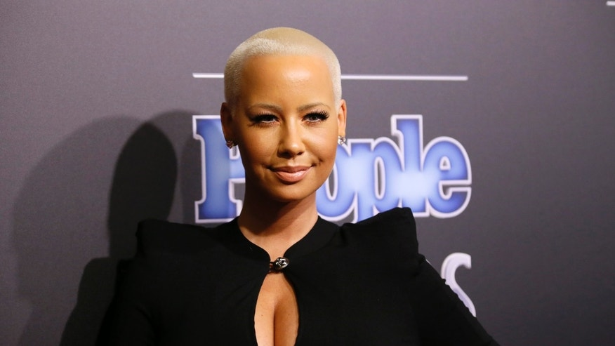 December 18, 2014.  Amber Rose arrives at the People Magazine Awards in Beverly Hills, California.