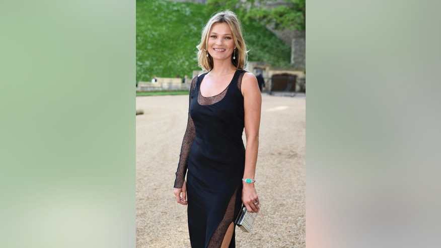 May 13, 2014. Model Kate Moss arrives for a dinner to celebrate the work of The Royal Marsden hosted by Britain Prince William at Windsor Castle, in Windsor.