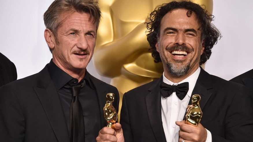 "Feb. 22, 2015: Presenter Sean Penn, left, and filmmaker Alejandro Iñárritu pose in the press room after winning multiple awards including best original screenplay, best director and best picture for ""Birdman: Or (The Unexpected Virtue of Ignorance),"" at the Oscars in Los Angeles."