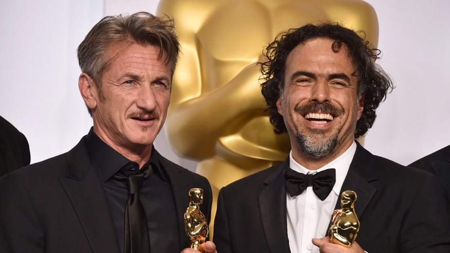 "FILE - In this Feb. 22, 2015 file photo, presenter Sean Penn, left, and filmmaker Alejandro Iñárritu pose in the press room after winning multiple awards including best original screenplay, best director and best picture for âBirdman: Or (The Unexpected Virtue of Ignorance),"" at the Oscars in Los Angeles. On Saturday, March 7,  during a promotional tour for his new film âThe Gunman,â in Beverly Hills, Penn opened up about the green card joke he made during the Oscars saying that he has âabsolutely no apologiesâ for his comment. âI found it hilarious,â Iñárritu said after the ceremony. âSean and I have that kind of brutal (relationship) where only true friendship can survive.â Iñárritu directed Penn in the 2003 film â21 Gramsâ and the two remain close to this date. (Photo by Jordan Strauss/Invision/AP)"