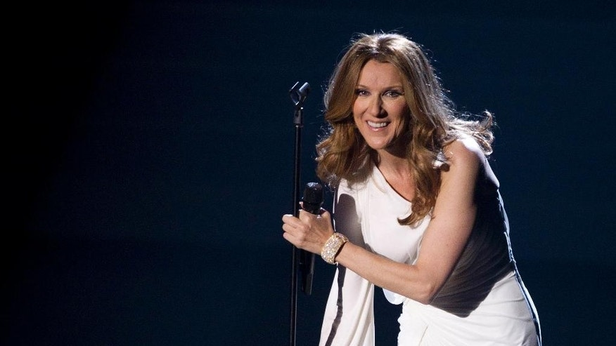 FILE - In this March 15, 2011 file photo, Celine Dion reacts to the audience during her opening night performance at Caesar's Palace, in Las Vegas. A representative for Dion says the performer will return to the stage but offered no dates for future performances. Dion hasn't performed since her July 29, 2014 show at The Colosseum at Caesars Palace in Las Vegas.  (AP Photo/Julie Jacobson, File)