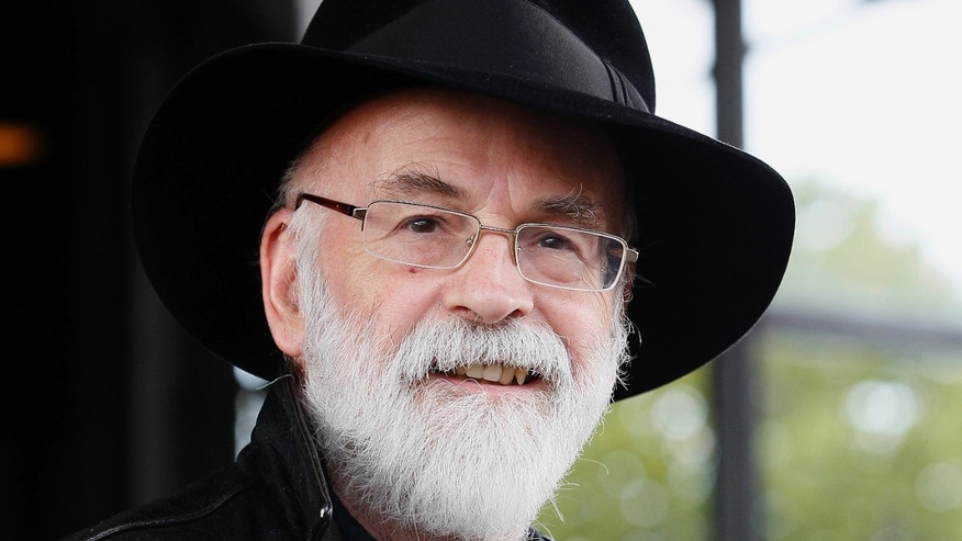 This is a Tuesday, Oct. 5, 2010 file photo of British author Terry Pratchett  seen at the Conservative party conference in Birmingham, England.  Pratchett, creator of the Discworld series, died Thursday March 12, 2015 aged 66.