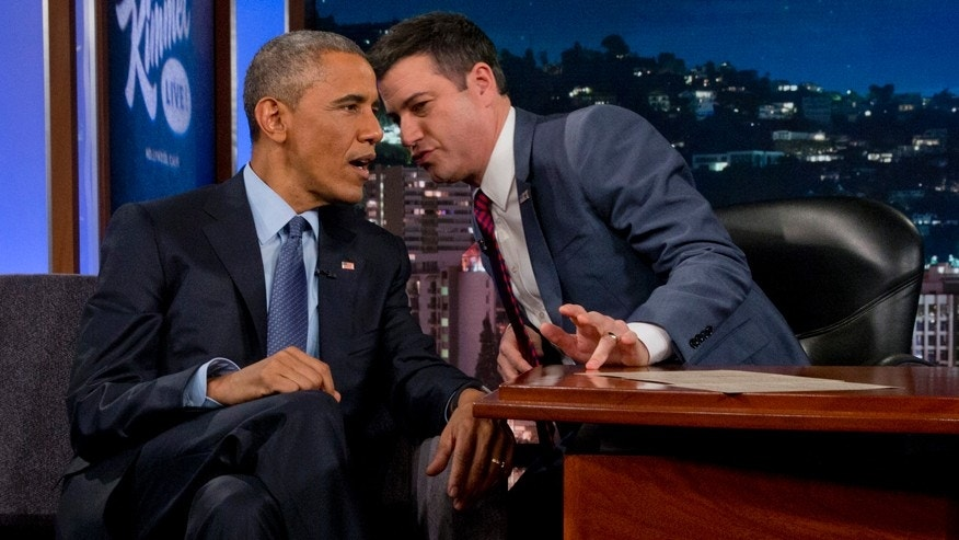 President Barack Obama talks with Jimmy Kimmel during a break in taping on Jimmy Kimmel Live, in Los Angeles Thursday, March 12, 2015. After the taping the president is expected to attend a DNC event.