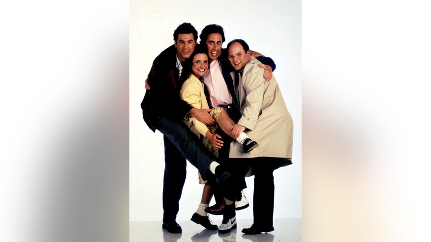 "Michael Richards, Julia Louis-Dreyfus, Jerry Seinfeld and Jason Alexander in ""Seinfeld."""