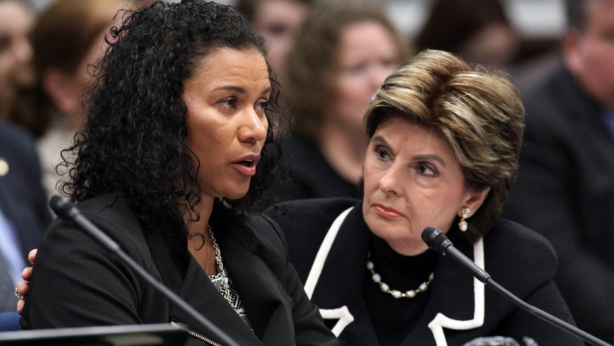 March 13, 2015. Attorney Gloria Allred, right, listens as Lise-Lotte Lublin testifies in a hearing at the Legislative Building in Carson City, Nev.