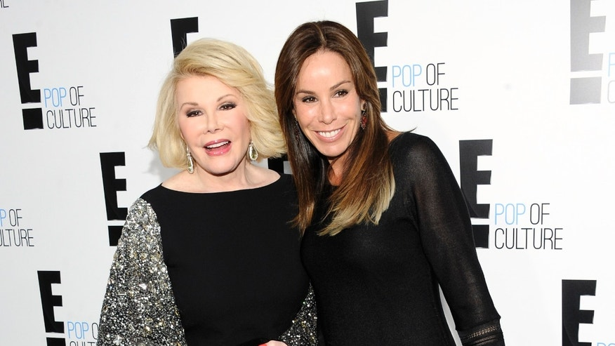 "April 30, 2012. Joan Rivers from the show ""Fashion Police"" and her producer daughter Melissa Rivers at an E! Network upfront event in New York."