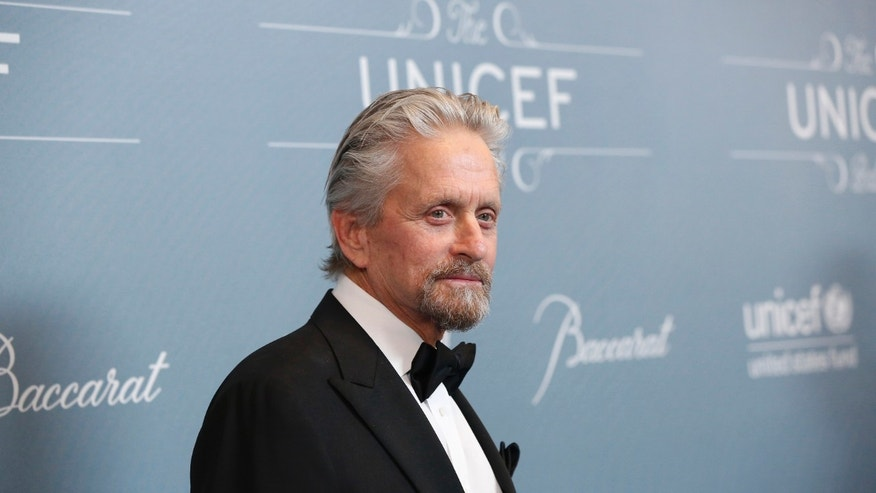 Actor Michael Douglas poses at the UNICEF Ball fundraising gala in Beverly Hills, California January 14, 2014.  REUTERS