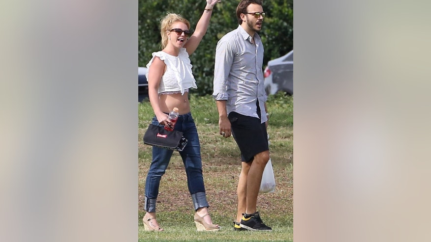 Britney Spears shows off toned tummy with new beau Charlie Ebersol.