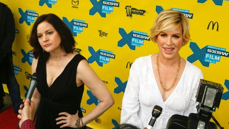 "Molly Ringwald, right, and Ally Sheedy talk to the media on the red carpet for ""The Breakfast Club"" 30th Anniversary Restoration World Premiere during the South by Southwest Film Festival on Monday, March 16, 2015 in Austin, Texas. (Photo by Jack Plunkett/Invision/AP)"