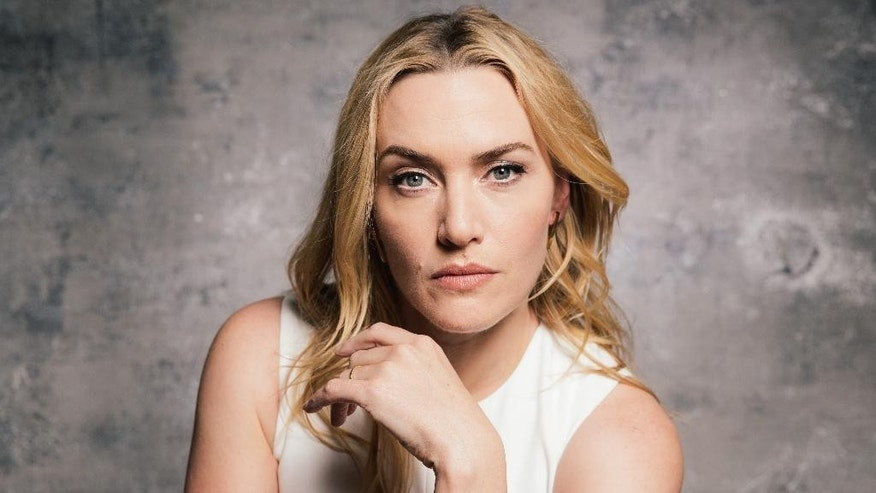 "In this Sunday, March 8, 2015 photo, actress Kate Winslet poses for a portrait for the film, ""The Divergent Series: Insurgent,"" at the Four Seasons Hotel, in Los Angeles. The movie opens in U.S. theaters on Friday, March 20, 2015. (Photo by Casey Curry/Invision/AP)"