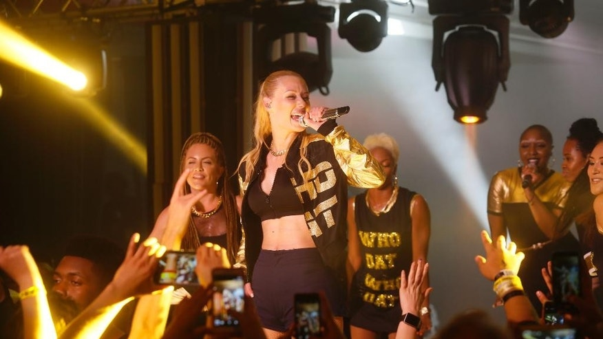 Iggy Azalea performs at the Samsung Milk Music Lounge during the SXSW Music Festival on early Thursday morning, March 19, 2015 in Austin, Texas. (Photo by Jack Plunkett/Invision/AP)