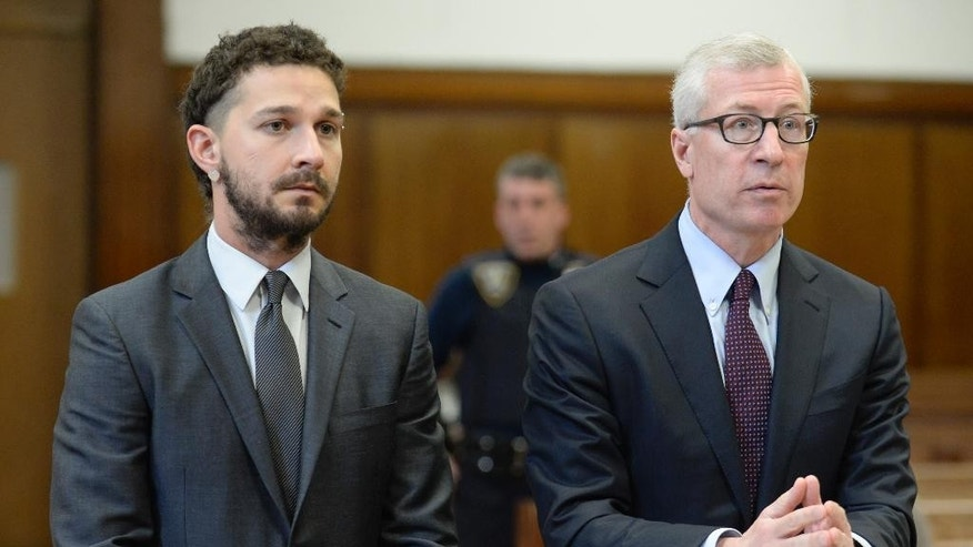 Actor Shia LaBeouf, left, appears in Manhattan Criminal court with his attorney Robert Gage, Friday, March 20, 2015, in New York.  (AP Photo/New York Post, Steven Hirsch, Pool)