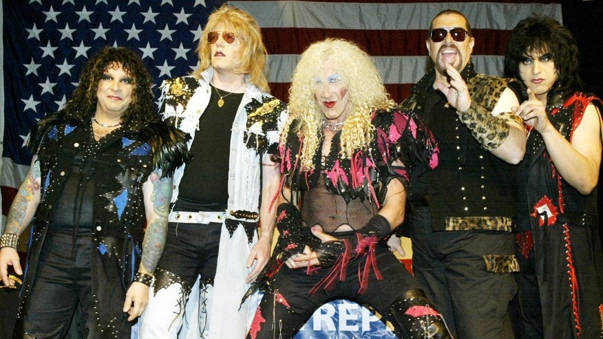 Members of the reunited metal band Twisted Sister, A.J. Pero (L), J.J. French (2nd L), Dee Snider (C), Mark Mendoza (2nd R), and Eddie Ojeda (R) pose for photos before a press conference in New York on April 29, 2003.