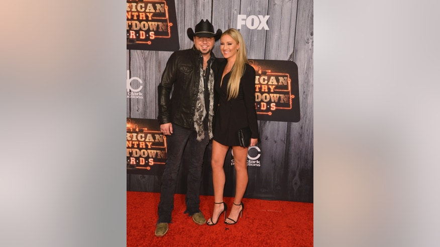 December 15, 2014. Recording artist Jason Aldean and Brittany Kerr arrive at the American Country Countdown Awards in Nashville, Tennessee.