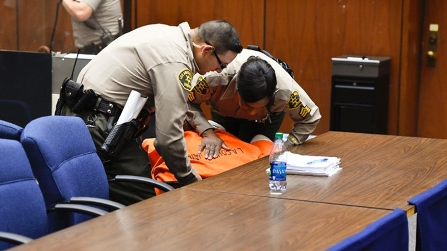 "March 20, 2015. Deputies rush to assist Marion ""Suge"" Knight, as he suddenly faints during an appearance in court for a bail review hearing in his murder case in Los Angeles."