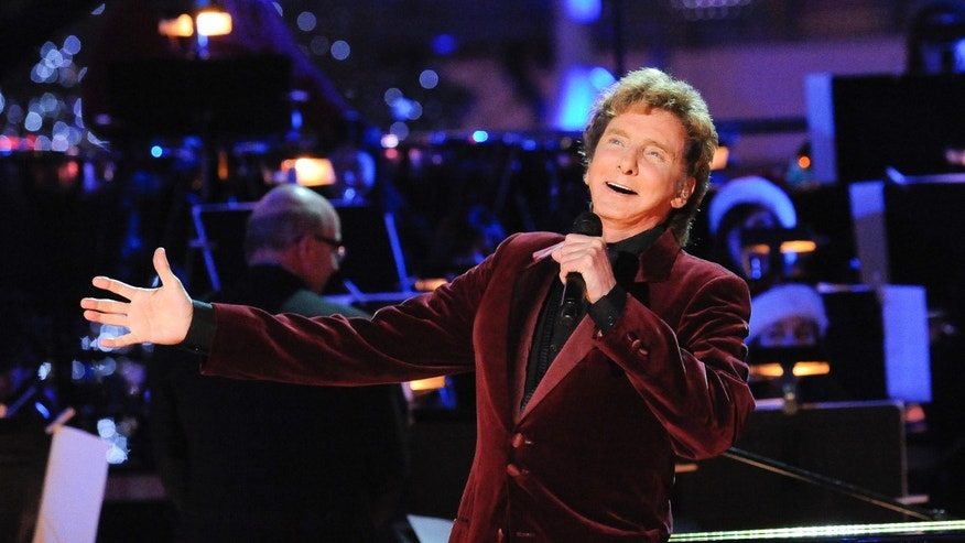 November 28, 2012. Singer Barry Manilow performs at the 5th Annual Holiday Tree Lighting at L.A. Live in Los Angeles, California.