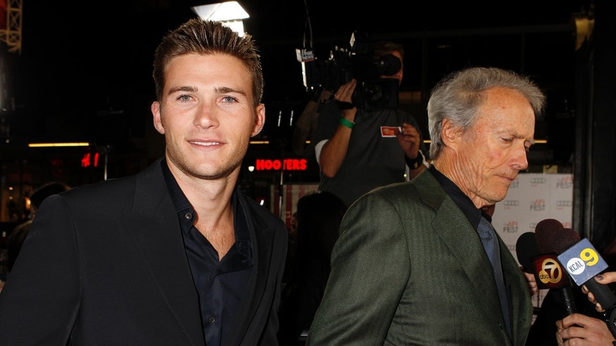 November 3, 2011. Director Clint Eastwood (R) is interviewed with his son Scott Eastwood at his side, at the opening night gala for AFI Fest 2011 in Hollywood.
