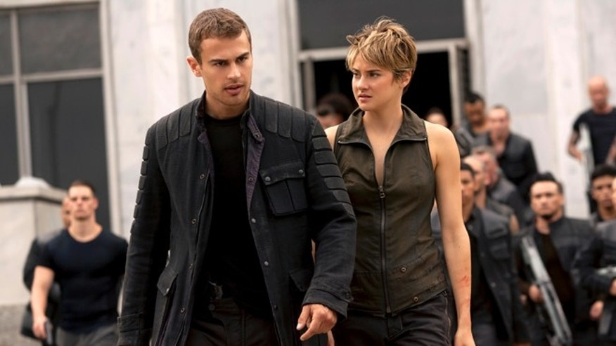 "Theo James, left, and Shailene Woodley appear in a scene from the film, ""The Divergent Series: Insurgent."""