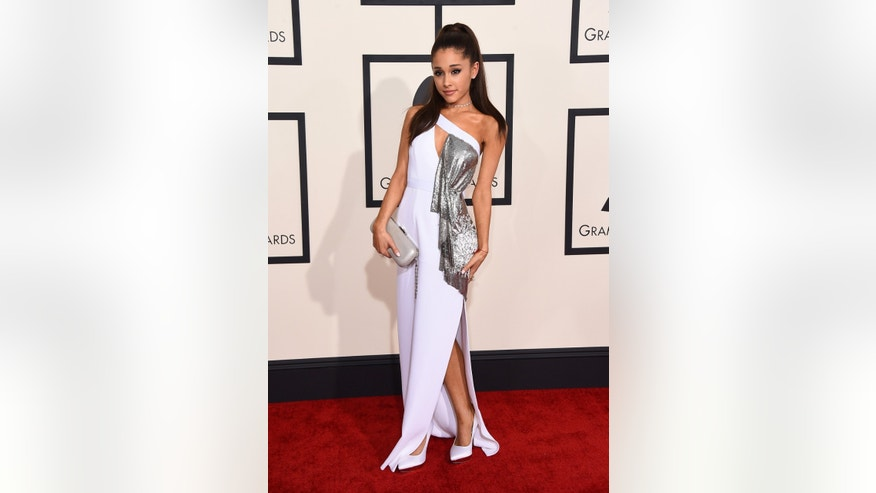 Ariana Grande wears a Versace gown as she arrives at the 57th annual Grammy Awards at the Staples Center on Sunday, Feb. 8, 2015, in Los Angeles. (Photo by Jordan Strauss/Invision/AP)