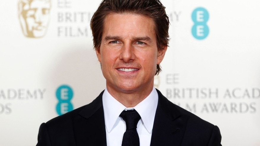 Actor Tom Cruise poses at the British Academy of Film and Arts (BAFTA) awards ceremony at the Royal Opera House in London February 8, 2015.
