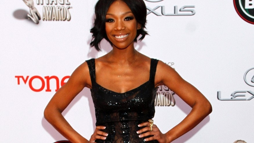 "In this Feb. 22, 2014 file photo, singer Brandy Norwood arrives at the 45th NAACP Image Awards  in Pasadena, Calif. Producers said Tuesday, March 24, 2015, that Norwood will make her Broadway debut next month as a woman behind bars in ""Chicago."""