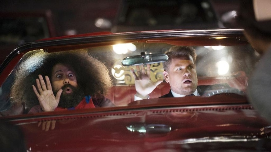 """In this photo released by CBS, Reggie Watts, left, and James Corden tape the opening titles for """"The Late Late Show with James Corden,"""" which debuts Monday, March 23 , 2015 (12:37 -- 1:37 a.m. ET/PT) on the CBS Television Network.  (AP Photo/CBS, Neil Jacobs)"""