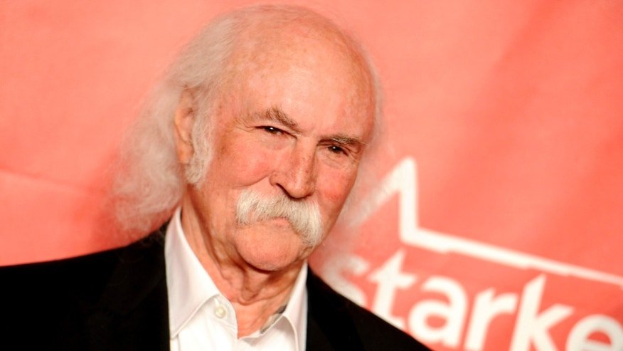 FILE - In this Feb. 6, 2015 file photo, David Crosby arrives at the 2015 MusiCares Person of the Year event at the Los Angeles Convention Center in Los Angeles. The Rock and Roll Hall of Famer Crosby hit and injured a jogger with his car in Southern California. The California Highway Patrol said in a statement that Crosby was driving his Tesla electric car Sunday, March 22, 2015, at around 55 mph, the posted speed limit on the road in the Santa Barbara area where Crosby lives. (Photo by Richard Shotwell/Invision/AP, File)