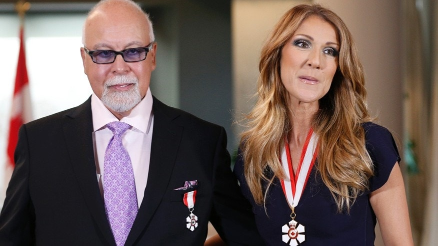 Canadian singer Celine Dion and her husband Rene Angelil pose after receiving the Order of Canada from Canada's Governor General David Johnston at the Citadelle in Quebec City, July 26, 2013.