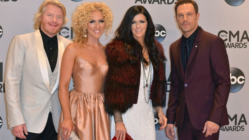 Phillip Sweet (L), Kimberly Schlapman (2nd from L), Karen Fairchild and Jimi Westbrook of Little Big Town arrive at the 48th Country Music Association Awards in Nashville, Tennessee November 5, 2014.