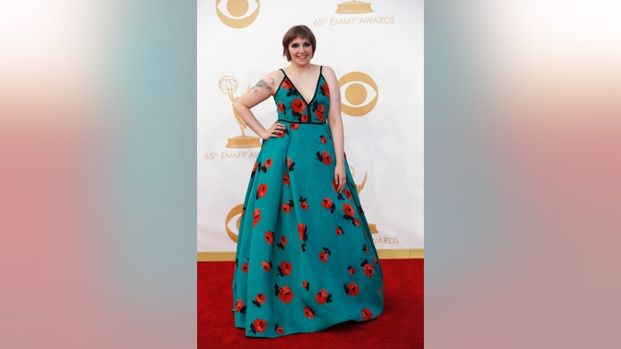 "Actress Lena Dunham from HBO's series ""Girls"" arrives at the 65th Primetime Emmy Awards in Los Angeles September 22, 2013. REUTERS/Mario Anzuoni (UNITED STATES Tags: ENTERTAINMENT) (EMMYS-ARRIVALS) - RTX13VUQ"