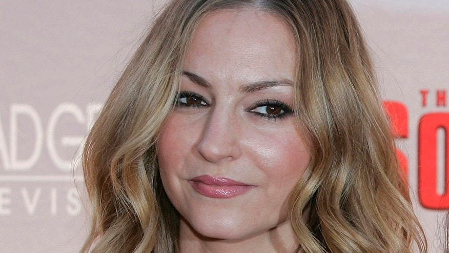 "Drea de Matteo attends the world premiere of two new episodes of HBO's ""The Sopranos""  on March 27, 2007, at Radio City Music Hall in New York."