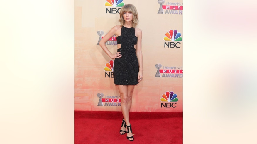 Taylor Swift arrives at the iHeartRadio Music Awards at The Shrine Auditorium on Sunday, March 29, 2015, in Los Angeles. (Photo by John Salangsang/Invision/AP)