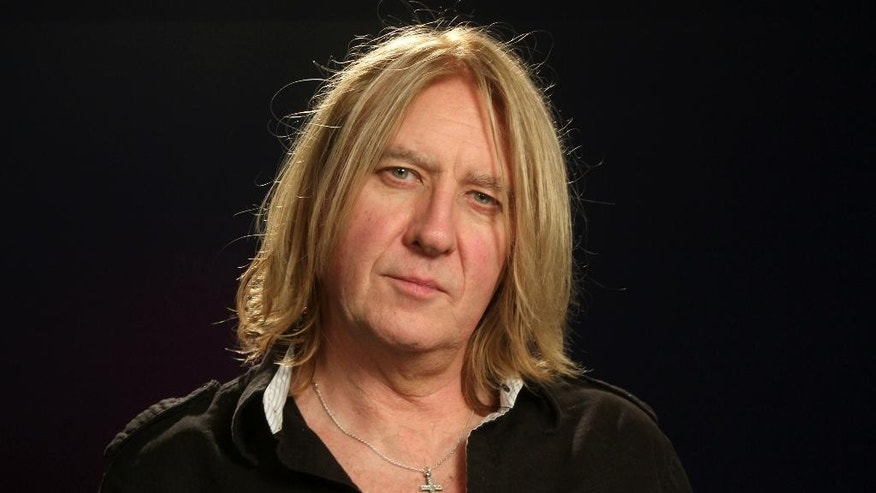 "In this Feb. 17, 2015 photo, Joe Elliott poses during an interview in New York. Elliott said it was important to tweak to the mantra of sex, drugs and roll 'n' roll in order to sustain the band's longevity, which has covered four decades. ""At the end of the day, the first thing that needs to go out of that phrase is the drugs. The rest can stay, but let's make rock and roll the important thing,"" said Elliot, who will go on a tour of North America with Styx and Tesla this year.  (AP Photo/John Carucci)"