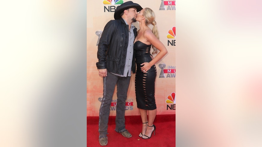 Jason Aldean, left, and Brittany Kerr arrive at the iHeartRadio Music Awards at The Shrine Auditorium on Sunday, March 29, 2015, in Los Angeles.