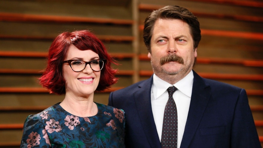 Actress Megan Mullally and actor Nick Offerman arrive at the 2014 Vanity Fair Oscars Party in West Hollywood, California March 2, 2014. REUTERS/Danny Moloshok (UNITED STATES TAGS: ENTERTAINMENT) (OSCARS-PARTIES) - RTR3FYVE