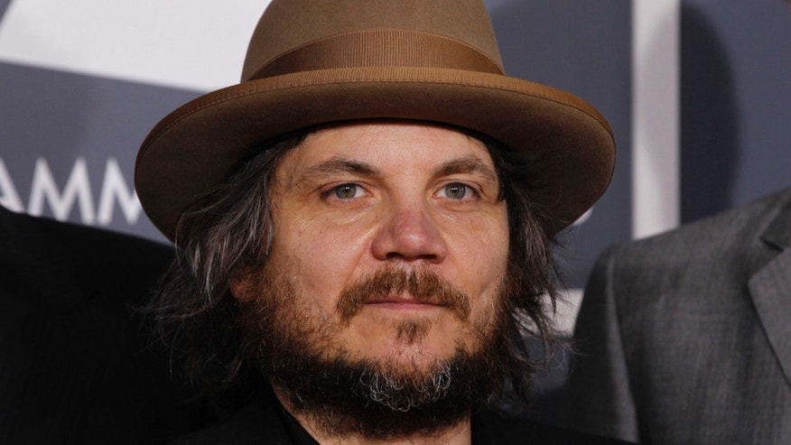 Jeff Tweedy, of the rock band Wilco, arrives at the 54th annual Grammy Awards in Los Angeles, California, February 12, 2012.  REUTERS/Danny Moloshok   (UNITED STATES) (GRAMMYS-ARRIVALS) - RTR2XQVG