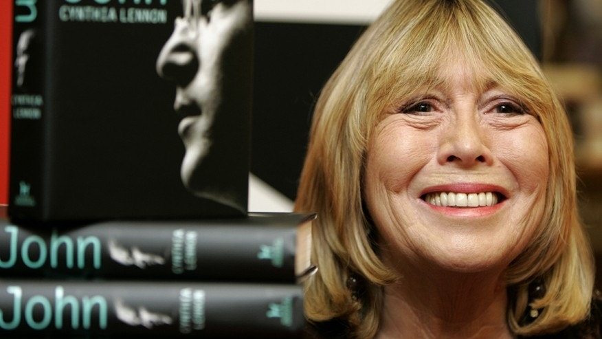 """Cynthia Lennon, first wife of former Beatle John Lennon, poses with copies of her newly published biography entitled """"John""""  at a central London bookshop September 26, 2005."""