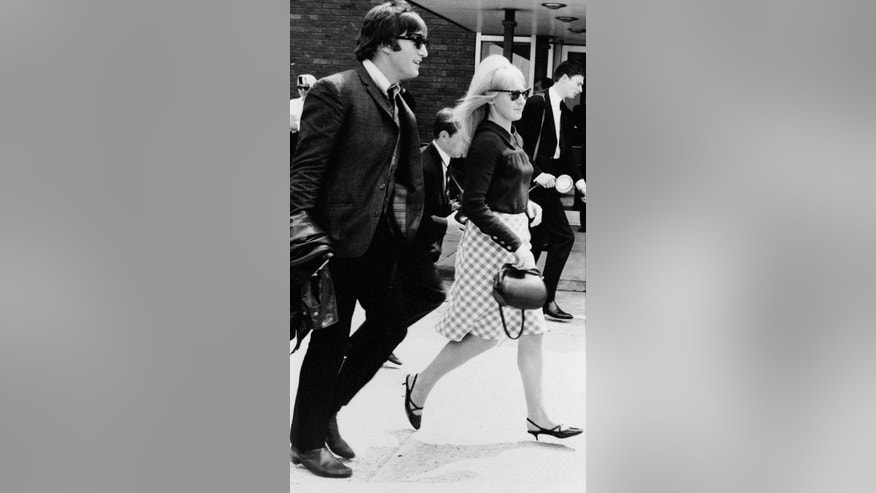 In this July 2,1964 file photo, singer John Lennon and his then wife, Cynthia, at Luton airport after 'The Beatles' arrived home from their three-week tour of Australia and New Zealand.