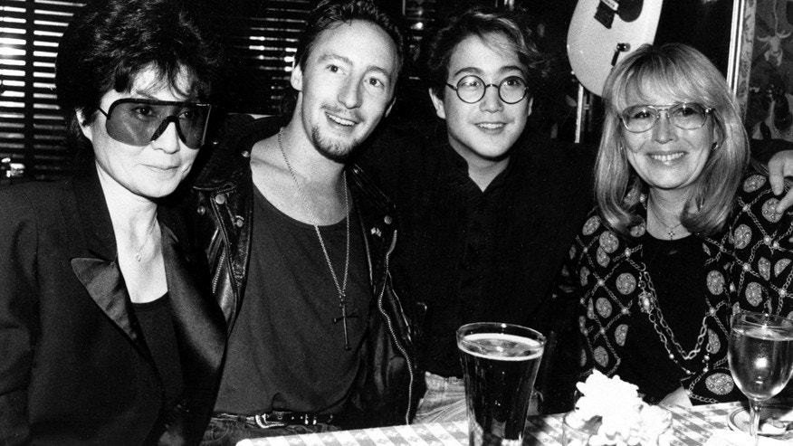 In this Aug. 3, 1989 file photo, the two wives and two sons of singer John Lennon, from left Yoko Ono, Lennon's second wife and widow; Julian Lennon; Sean Lennon, son with Ono; and Cynthia Lennon, first wife and mother of Julian pose together at the Hard Rock Cafe in New York City to celebrate Julian's concert at the Beacon Theater, New York.