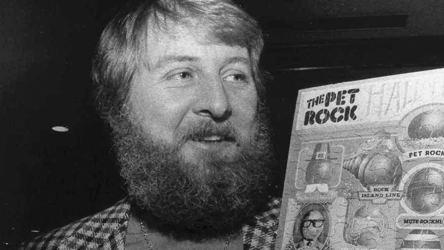 Gary Dahl, originator of the Pet Rock, holds Pet Rock items in 1976.