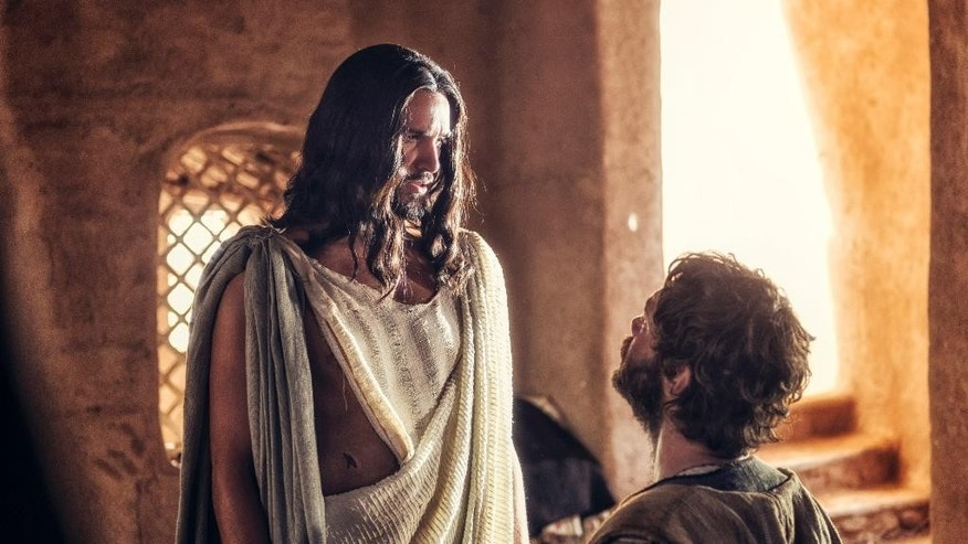 "In this image released by NBC, Juan Pablo Di Pace portrays Jesus, left, and Johannes Haukur Johannesson portrays Thomas in a scene from ""A.D. The Bible Continues."" The first of the 10 episodes airs on Easter, picking up where its predecessor, the wildly popular ""The Bible"" series from the History Channel left off and going on to tell the story of what happened to Christ's disciples after the crucifixion. (AP Photo/LightWorkers Media/NBC, Joe Alblas)"