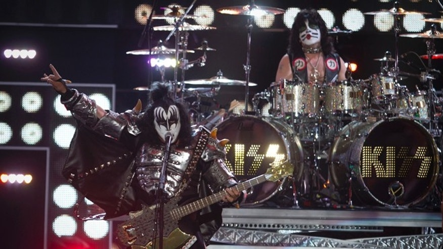 "September 9, 2014. Gene Simmons (L) and Eric Singer of the band Kiss perform during the ""Fashion Rocks 2014"" concert in the Brooklyn borough of New York."