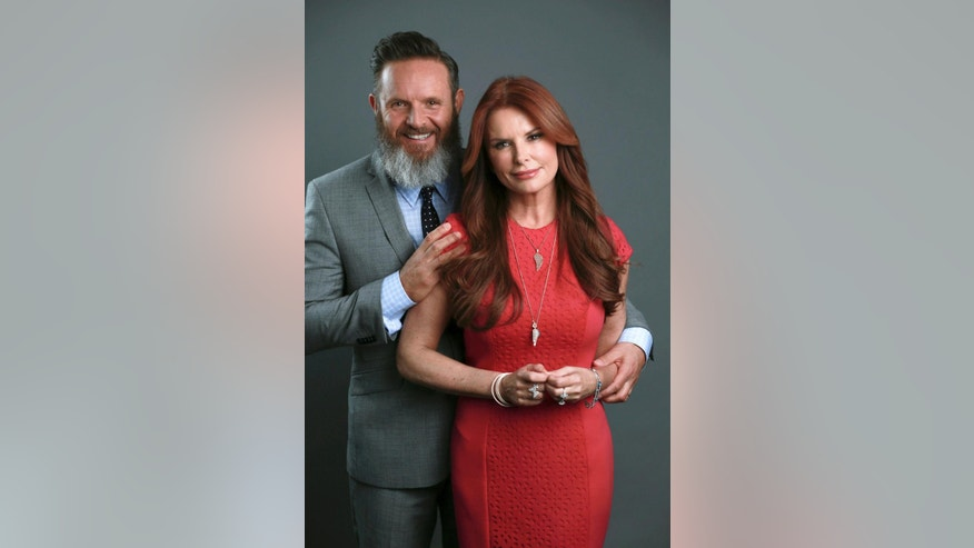 "In this March 30, 2015 photo, husband and wife creative team Mark Burnett, left, and Roma Downey pose for a portrait in promotion of their upcoming series ""A.D. The Bible Continues"" which premieres on NBC Network on Easter Sunday, April 5, 2015 in New York. (Photo by Amy Sussman/Invision/AP )"