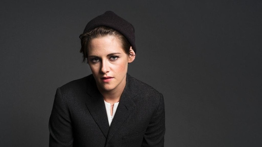 "In this Oct. 8, 2014 photo, actress Kristen Stewart poses for a portrait in New York. Stewart stars in ""The Clouds of Sils Maria,"" directed by French filmmaker Olivier Assayas, opening in theaters April 10. (Photo by Drew Gurian/Invision/AP)"