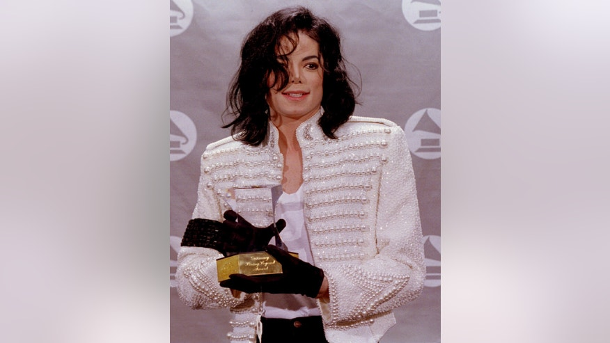 Michael Jackson holds his Grammy Living Legend Award at the 35th Grammy Awards show.