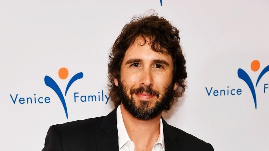 FILE - In this March 9, 2015, file photo, singer Josh Groban attends the 2015 Silver Circle Gala in Beverly Hills, Calif. Groban has been selected to sing the national anthem at the annual Kentucky Derby, to be held May 2, 2015, at the Churchill Downs racetrack in Louisville, Ky. (Photo by Chris Pizzello/Invision/AP, File)