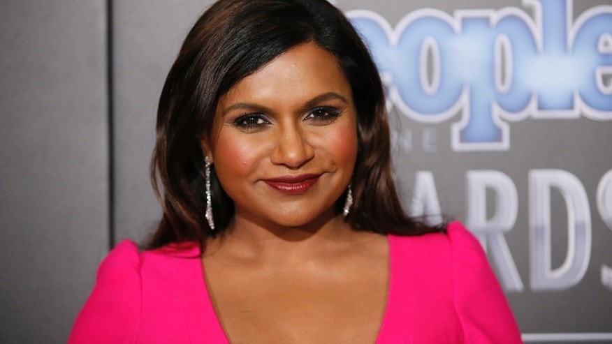 Actress Mindy Kaling poses backstage at the People Magazine Awards in Beverly Hills, California December 18, 2014.