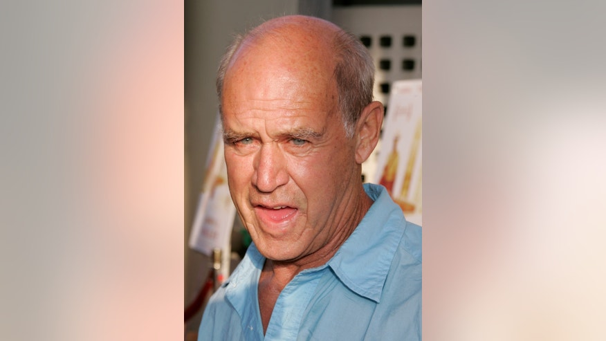 "Actor Geoffrey Lewis, father of actress Juliette Lewis, arrives as a guest for the premiere of the new drama film ""Down in the Valley"" at the opening night of the Los Angeles Film Festival in Hollywood June 16, 2005. REUTERS"