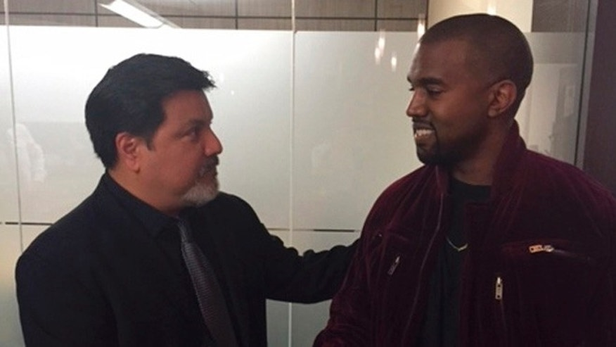 This March 2015 photo provided by courtesy of Allred, Maroko and Goldberg shows videographer Daniel Ramos, left, and Kanye West, shaking hands after West apologized to Ramos as part of a settlement, in Los Angeles. This assault case was set for trial next week on April 14, 2015, but Ramos' lawyer, Gloria Allred, filed for a dismissal on April 7, after a settlement was agreed to by both parties. One important aspect of the settlement was an apology by West to Ramos. (AP Photo/Courtesy Allred, Maroko and Goldberg)