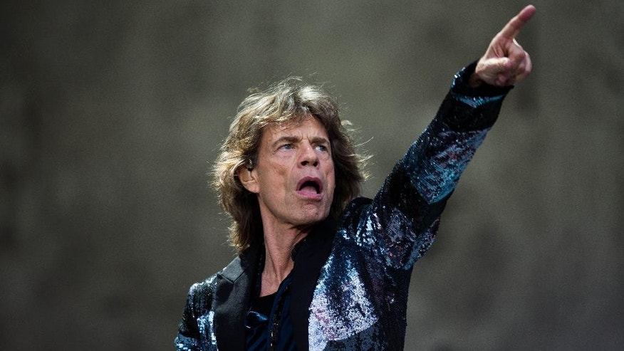 "FILE - In this June 10, 2014, file photo, Rolling Stones singer Mick Jagger performs during a concert  for the ""14 On Fire"" tour in Berlin.  The Fox television series ""Empire"" is a powerhouse, but it might have just received its biggest endorsement:  Jagger says he's a fan of the musical drama series.  (AP Photo/Markus Schreiber, File)"